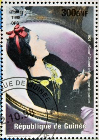 GUINEA - CIRCA 1998: a stamp printed in Republic of Guinea commemorating Coco Chanel created her perfume line, circa 1998.